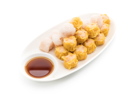 Stream shrimp dumplings with sauce on white background