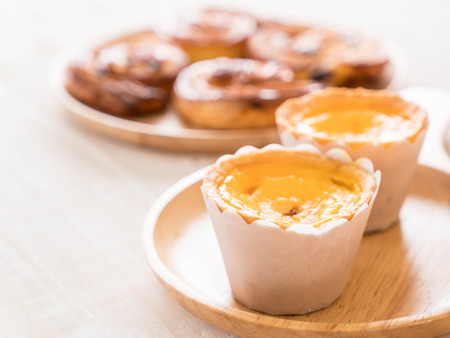 egg tart on wood plate