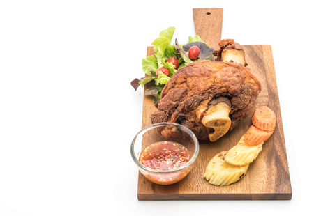 Crispy pork knuckle or German Pork Hocks on white background Stock Photo