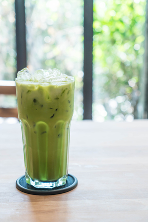 iced green tea latte in cafe Stock Photo