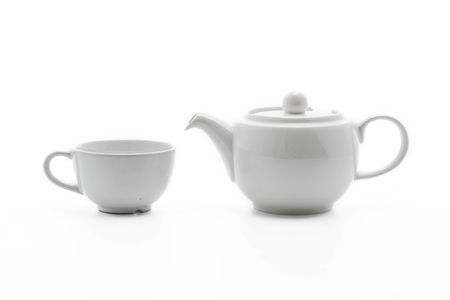 white tea pot with tea cup on white background