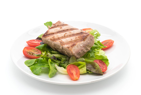tuna steak with salad on white background
