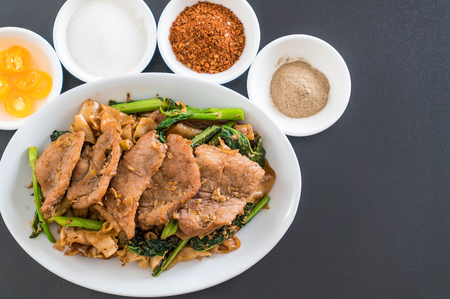 peanut sauce: fried noodles with soy sauce and pork with condiments
