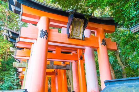 Selective Focus Point - Red Tori Gate at Fushimi Inari Shrine in Kyoto, Japan.