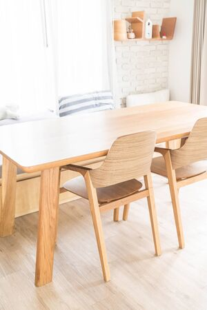 kitchen furniture: wood dinning table interior decoration Stock Photo