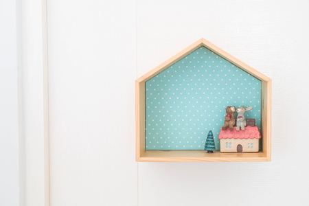office furniture: doll on wood shelf interior decoration