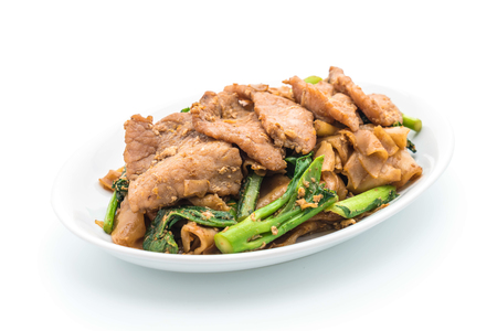 peanut sauce: fried noodles with soy sauce and pork on white background