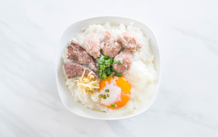 rice porridge with pork and egg with ingredient