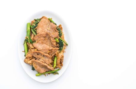 fried noodles with soy sauce and pork on white background