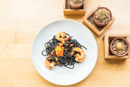 stir-fried black spaghetti with shrimp Stock Photo