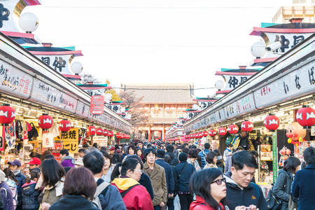 dori: Toyko, Japan - 28 NOV 2016: Tourists walk on Nakamise Dori in Sensoji shrine. Sensoji temple at Japan.