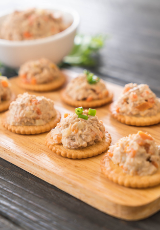 tuna spread with cracker on wood board Stock Photo