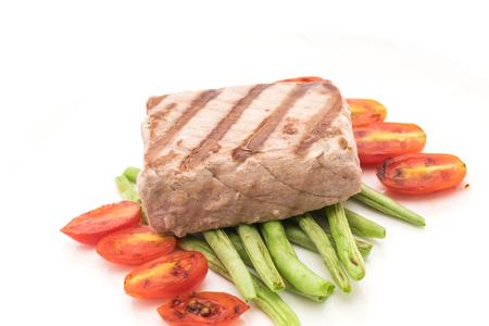 tuna steak with salad on white background