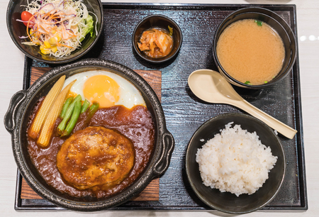 pork burger with fried egg in hot plate - japanese food