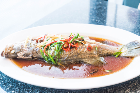 Steamed snapper with soy sauce on plate