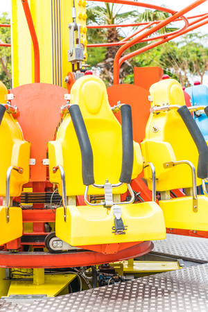 round chairs: Colorful roller coaster seats at amusement park in Thailand