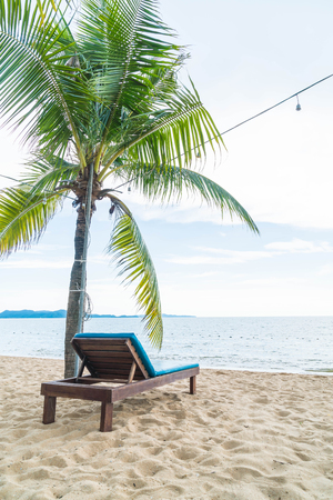 Beach chair, Palm and tropical beach at Pattaya in Thailand - boost up color and lighting processing style Reklamní fotografie