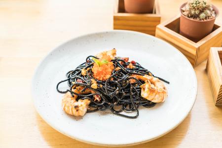 stir-fried black spaghetti with shrimp Stock Photo