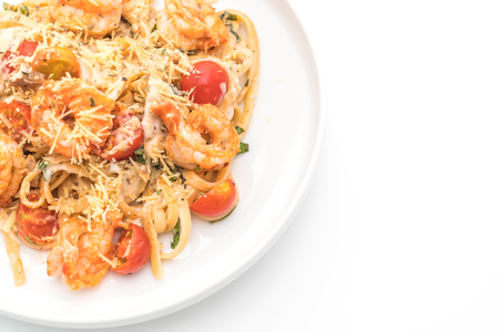 spaghetti with shrimps and tomatoes on white background Stock Photo