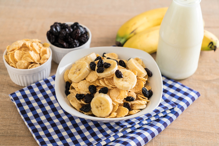 cereal with banana, raisin and milk for breakfast