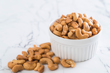Roasted cashew nuts in bowl Stock Photo