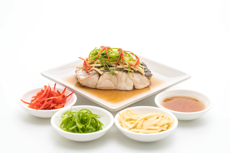 snapper fish steamed with soy sauce isolated on white background