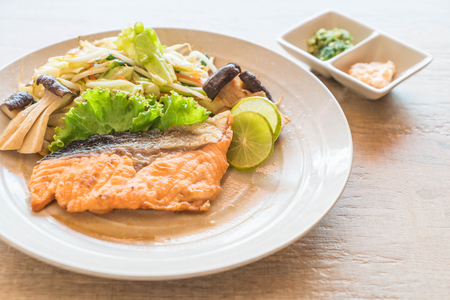 fried salmon steak with vegetable - japanese food style Stock Photo
