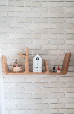 living room design: clock on wood shelf interior decoration Stock Photo