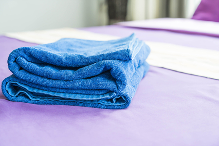 bed sheet: towel on bed decoration in bedroom  - selective focus point Stock Photo