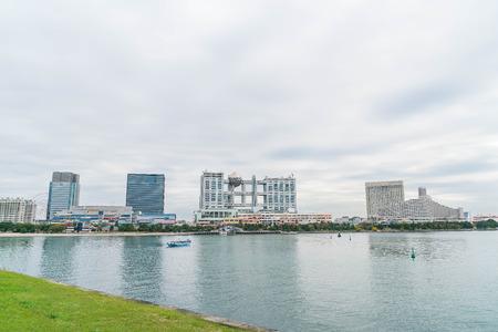 cruising: Tokyo, Japan - NOV 16, 2016 : Tokyo cruise boat cruising infront of Odaiba Aqua city shopping mall and Fuji Television building, Odaiba, Tokyo