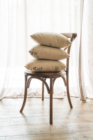 pillow on chair with curtain background