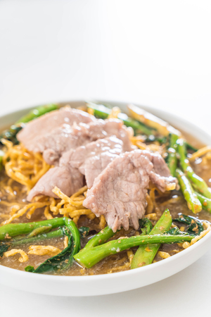 crispy egg noodles with chinese broccoli and pork with condiments