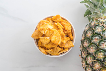 dried pineapple crispy chips in bowl