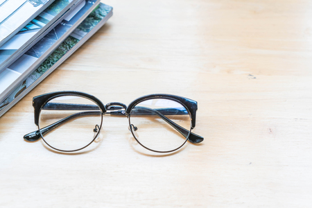 glasses with book or magazine