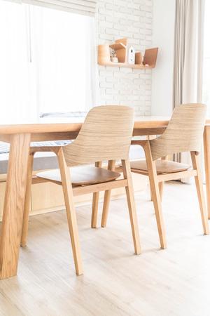luxury apartment: wood dinning table interior decoration Stock Photo