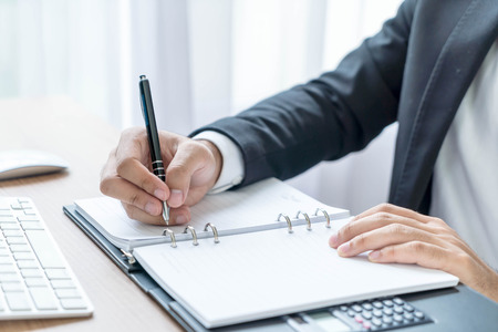autograph: Close-up hand of businessman writing on note Stock Photo