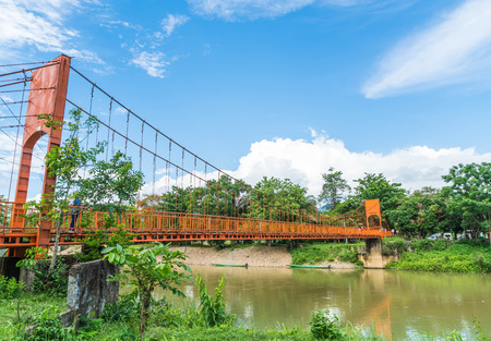 jung: Orange bridge cross the river at Jung cave in Vang Vieng, Laos.
