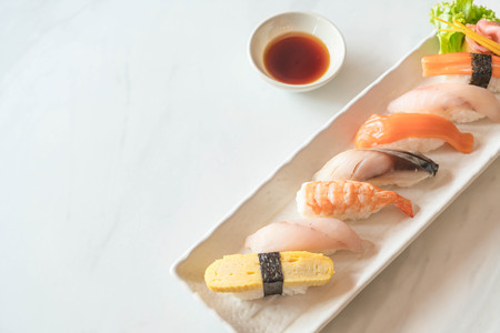 Raw and fresh nigiri sushi in white plate - Japanese food style Stock Photo