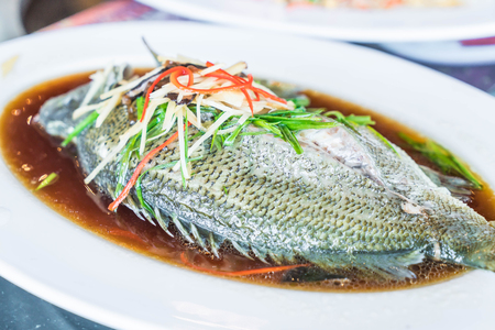 steamed jade perch with soy sauce on plate