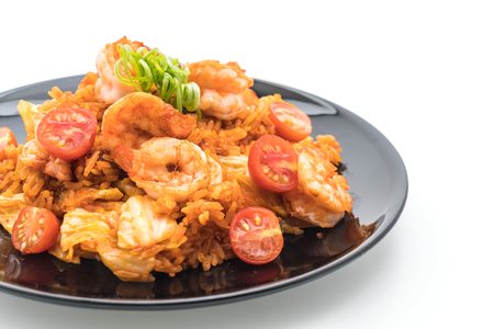 fried rice with korea spicy sauce and shrimps - korean food style on white background