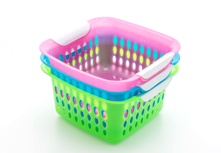 carrying: colorful plastic basket isolated on white background