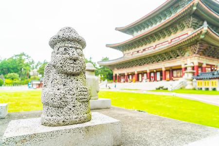 Dol Harubang at Yakcheonsa Temple in Jeju Island, South Korea Stock Photo