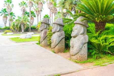 colonnade: Dol Harubang in park at Jungmun Daepo Coast Jusangjeolli Cliff, Jeju Island, South Korea