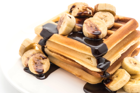 banana waffle with chocolate on white background