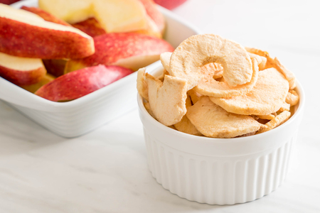 dried apple chips in bowl Stock Photo