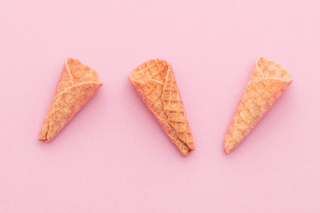 cornet: empty wafer cone on pink background Stock Photo
