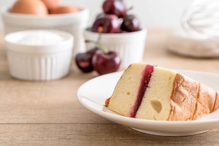 cherry chiffon cake on table