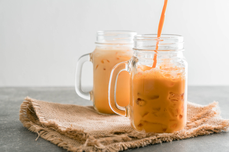 iced thai milk tea in glass Stock Photo