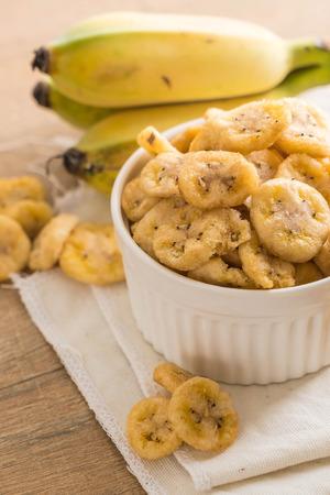 banana crispy chips in bowl Stock Photo