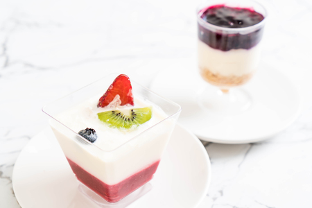 panna cotta with strawberry sauce on table Stock Photo
